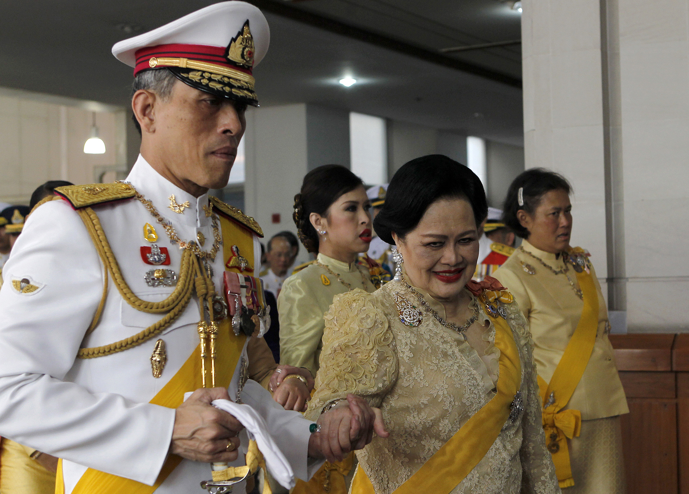 Thailand's royal family follows King Bhumibol Adulyadej as he returns to Siriraj Hospital in Bangkok